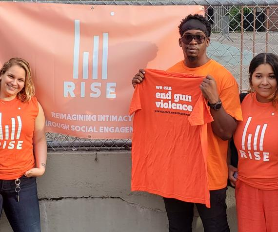 RISE Project staff in orange t-shirts