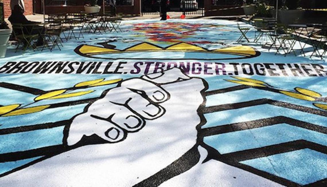 Brownsville Stronger Together mural; shows two hands clasped together