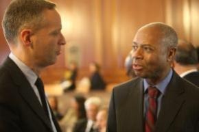 Greg Berman, director of the Center for Court Innovation, confers with Bronx D.A. Robert Johnson.