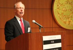 Judge Steven Jahr, administrative director of the courts in California, addresses the summit. The California Administrative Office of the Courts hosted the summit in its headquarters in San Francisco.