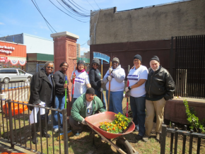 Cleaning up a Belmont Avenue community garden.
